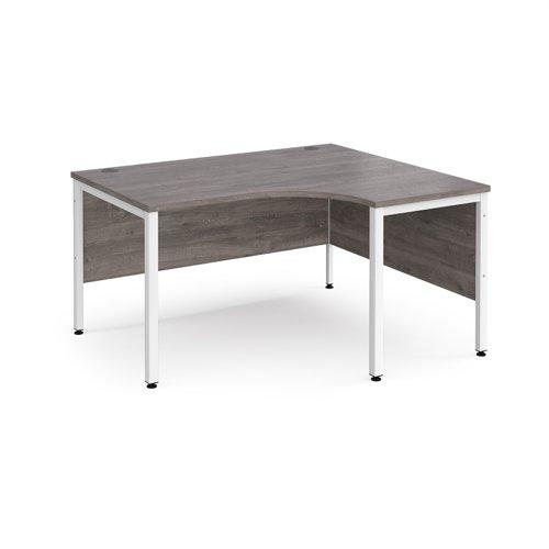 Maestro 25 right hand ergonomic desk 1400mm wide - white bench leg frame and grey oak top
