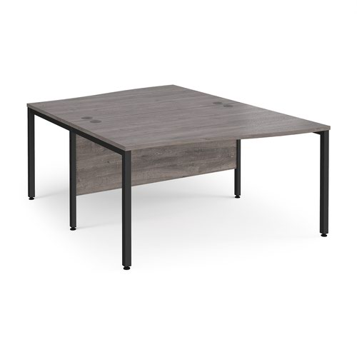 Maestro 25 back to back wave desks 1400mm deep - black bench leg frame and grey oak top