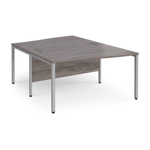 Maestro 25 back to back wave desks 1400mm deep - silver bench leg frame and grey oak top