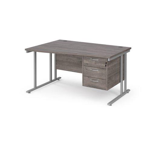 Maestro 25 left hand wave desk 1400mm wide with 3 drawer pedestal - silver cantilever leg frame and grey oak top
