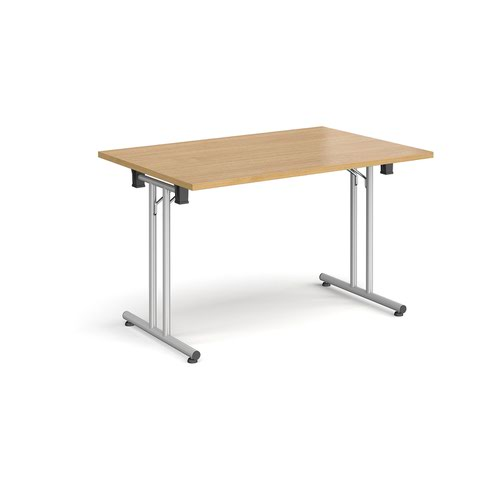 Rectangular folding leg table with silver legs and straight foot rails 1200mm x 800mm - oak
