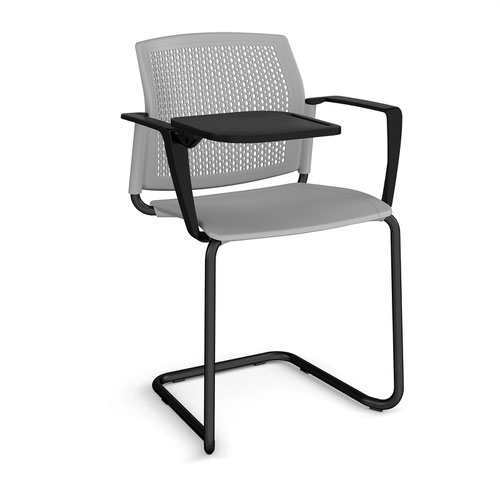 Santana cantilever chair with plastic seat and perforated back and black frame with arms and writing tablet - grey