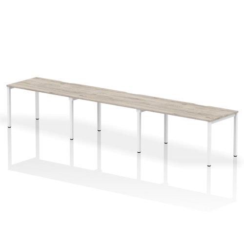 Single White Frame Bench Desk 1400 Grey Oak (3 Pod)