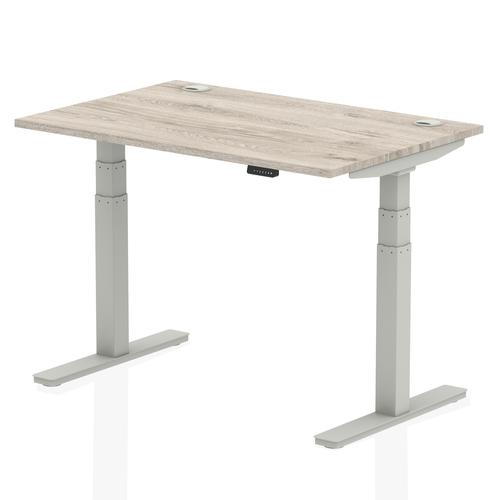 Air 1200/800 Grey Oak Height Adjustable Desk With Cable Ports With Silver Legs