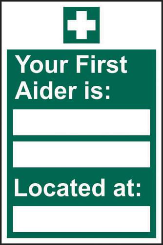 Your First Aider Is: _____ Located At: _____ sign (200 x 300mm). Manufactured from strong rigid PVC and is non-adhesive; 0.8mm thick.