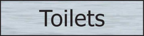 Self adhesive semi-rigid Toilets Sign in Stainless Steel Effect (200 x 50mm). Easy to fix; peel off the backing and apply.