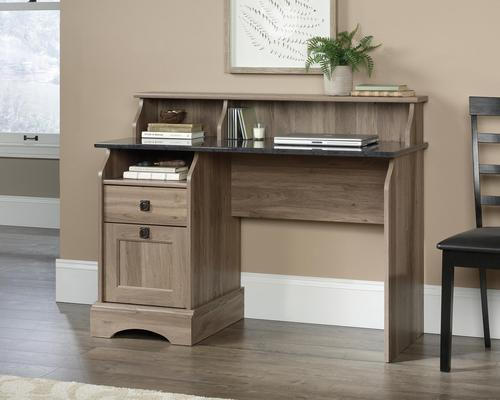 Teknik Office Farmhouse Desk with Salt Oak Finish and Rosso Slate accents two storage drawers and cubbyhole storage