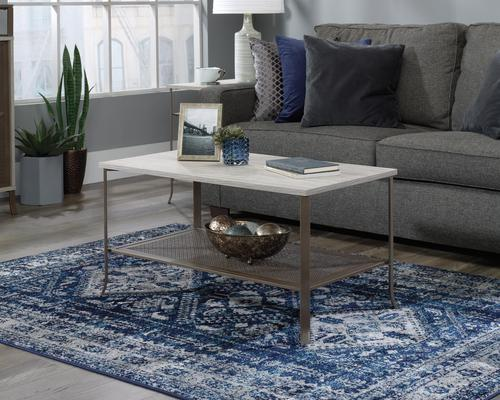 Teknik Office City Centre Coffee Table in Champagne Oak finish with spacious top and lower open shelf storage and durable satin taupe metal frame