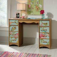 Teknik Office Boutique Style Desk Scribed Oak finish; Front panels feature bird and floral patterns with two drawers and two adjustable shelves